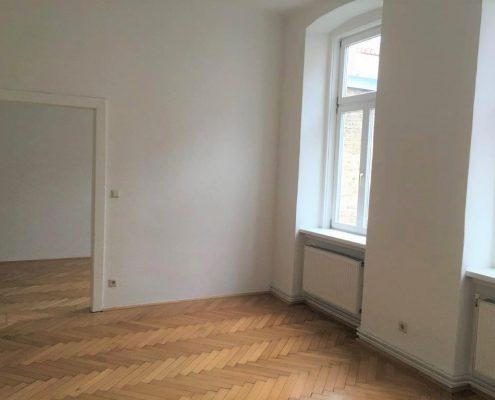 1050 Altbaumietwohnung Wohnzimmer